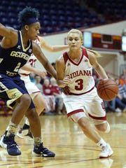 Submitted photo Tyra Buss (3) drives against Georgia Tech's Aalyiah Whiteside (2) during a game Dec. 2. Buss is back at point guard this year for IU.