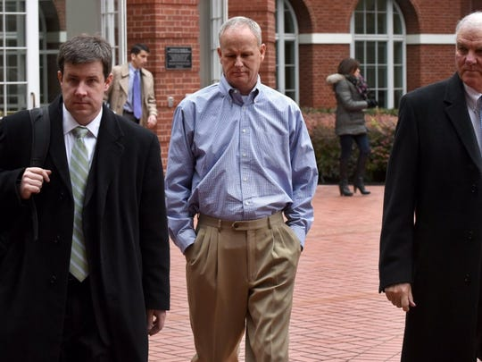 "Former Pilot Flying J Vice President of Sales John ""Stick"" Freeman, center, leaves federal court after being arraigned on charges including conspiracy to commit wire fraud and mail fraud. Freeman pleaded guilty earlier this year."