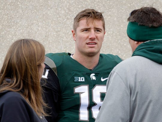 Michigan State quarterback Connor Cook, center, is the odds-on favorite to be the All-Big Ten first-team quarterback, but late-season games at Ohio State and Penn State loom.