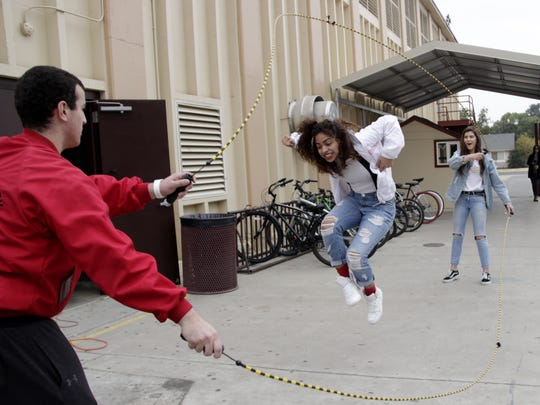 Tulare Union High School students Evan Garcia, Adream Gallegos and Emily Moore participate in a double Dutch lunchtime activity for Bell Week on Thursday afternoon.