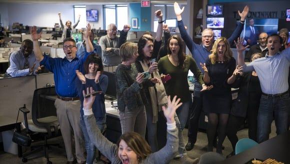 Staff members of the Cincinnati Enquirer celebrate