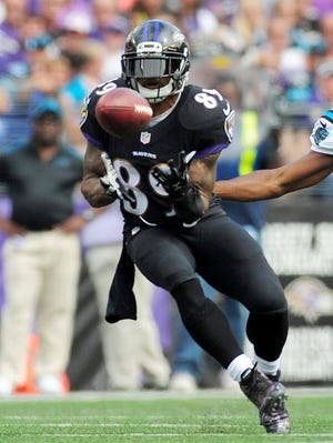 Baltimore Ravens wide receiver Steve Smith, Sr. (89) catches a pass in front of Carolina Panthers cornerback Josh Norman (24) in the second quarter at M&T Bank Stadium.