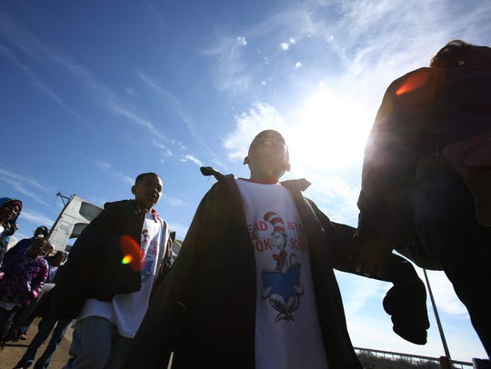 School children cross over the historic Edmund Pettus