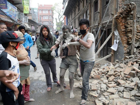People free a man from the rubble of a destroyed building