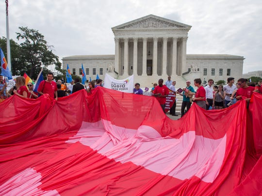 Supporters of gay marriage unfurl a so-called equality flag outside the Supreme Court, where the justices will soon hand down their decision on the matter in Washington, DC, USA, 26 June 2015.