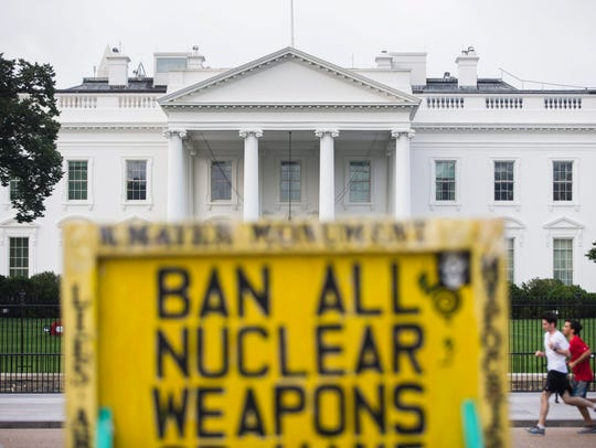 A protester's sign is seen outside the White House