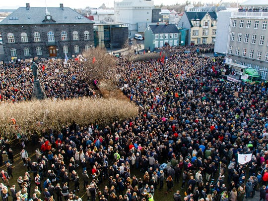 People gathered during a protest on Austurvollur Square
