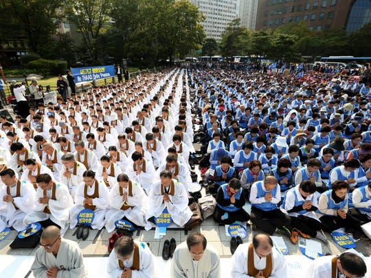 South Korean Won Buddhists pray during a rally held