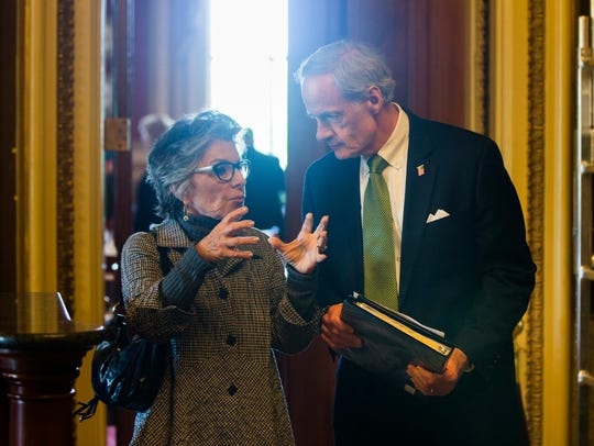 Sen. Barbara Boxer, D-Calif., chats with Sen. Tom Carper,