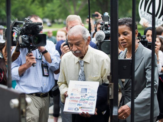 Democratic Congressman from Michigan John Conyers (C) attempts to pass through the Northwest gate of the White House to deliver 'more than 2 million signatures in support of expanding social security benefits' in Washington, DC, USA, 13 July 2015.