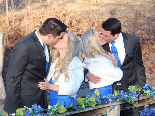 Twin sisters Brittany, left, and Briana Deane kiss their fiances, twin brothers Josh, left, and Jeremy Salyers after they proposed in Virginia Feb. 2.