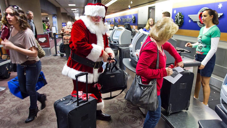 Holiday travelers check in  at the Southwest Airlines