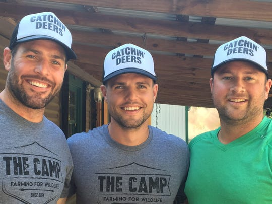 Predators forward Mike Fisher (left), his younger brother Bud Fisher (center), and friend Austin Casselman (right) show off their Catchin' Deers hats.
