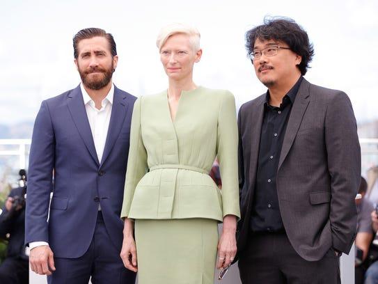 'Okja' star Jake Gyllenhaal, left, Tilda Swinton and