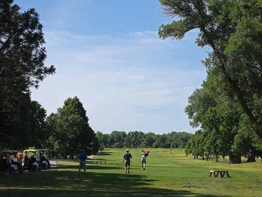 Golfers tee off on Elmwood Golf Course's sixth hole