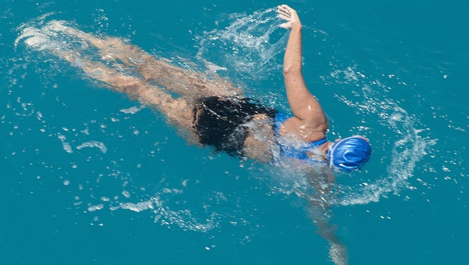 Diana Nyad, 64, swims towards the completion of her approximately 110-mile trek from Cuba to the Florida Keys.