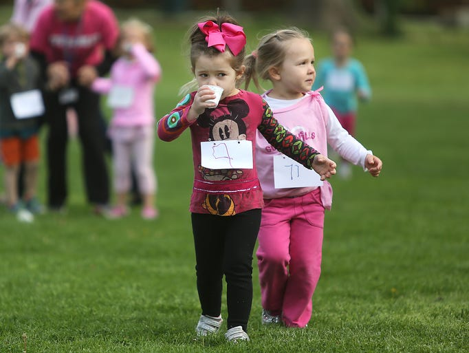 Ila Pietoso (left) and Lynley Burton run together during the 10th annual Flying Pig Mini-Marathon at the Seven Hills Doherty School in East Walnut Hills.