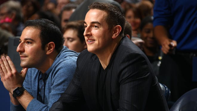 December 7, 2014 -  Joe Abadi, left, and Memphis Grizzlies controlling owner Robert Pera watch the Grizzlies play the Miami Heat at the FedExForum. (Nikki Boertman/The Commercial Appeal)