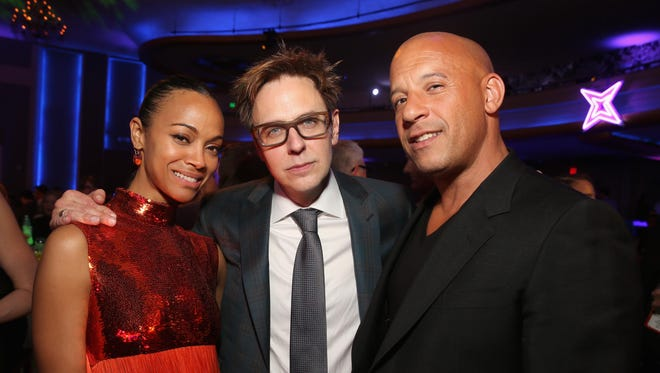 "Actor Zoe Saldana, Writer/director James Gunn and actor Vin Diesel at The World Premiere of Marvel Studios' ""Guardians of the Galaxy Vol. 2."" at Dolby Theatre in Hollywood, California April 19th, 2017."