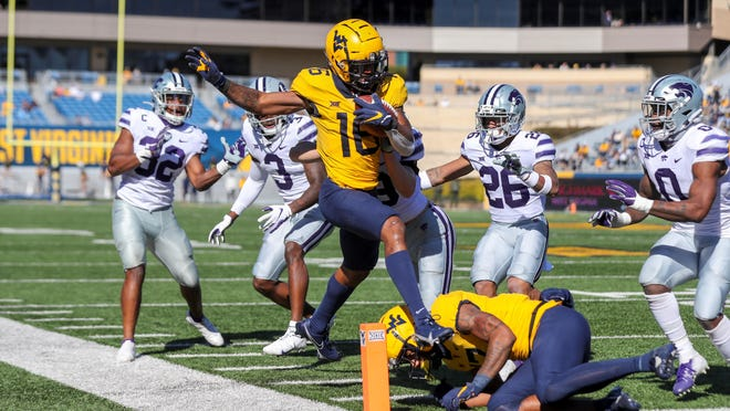 West Virginia wide receiver Winston Wright (16) makes a catch and runs for a touchdown during the second quarter against the Kansas State on Saturday at Milan Puskar Stadium in Morgantown, W.Va.