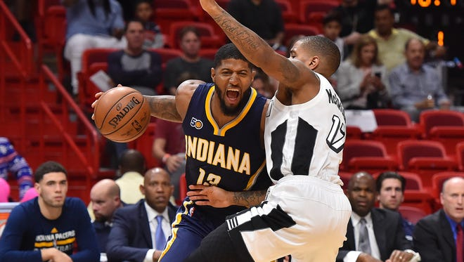 Miami Heat guard Rodney McGruder (17) fouls Indiana Pacers forward Paul George (13) during the first half at American Airlines Arena.
