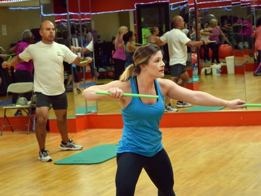 """Brittani Stout (front, right), a Pound instructor at the Courtyard Health & Racquet Club in Alexandria, leads one of three Pound classes that the Courtyard offers. """"It's a really good workout for your core and your whole body,"""" said Diego Quesada (back, f"""