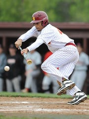 McCutcheon senior Billy Loft lays down a perfect bunt