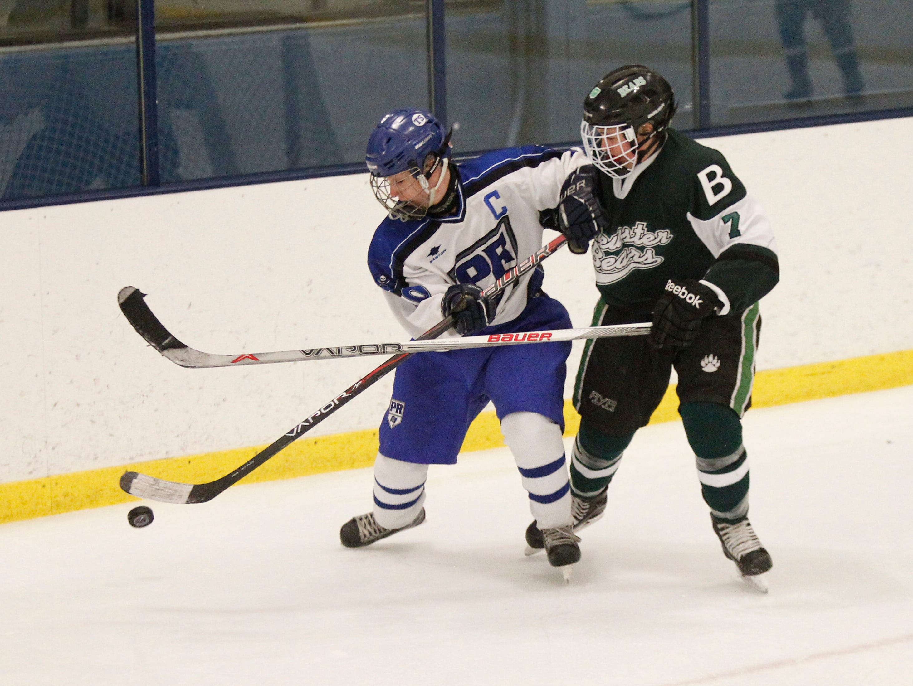 Pearl River's Brian Caffrey (10) , left, and Brewster's Rory McLaughlin (7) battle for possession during their 4-4-overtime tie at Sport-O-Rama in Monsey on Saturday, Jan. 9, 2016.
