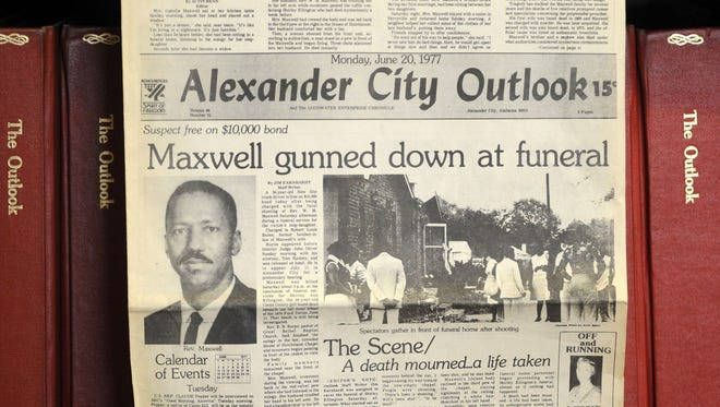 """This photograph taken Thursday, Aug. 27, 2015, in Alexander City, Ala., shows the front page of the town newspaper following the slaying of Willie Maxwell in 1977. """"To Kill a Mockingbird"""" author Harper Lee researched his slaying and a string of other killings, but no book was ever published. Robert Burns, who shot and killed Maxwell but was later acquitted by reason of insanity, met with Lee twice to discuss the case. (AP Photo/Jay Reeves)"""