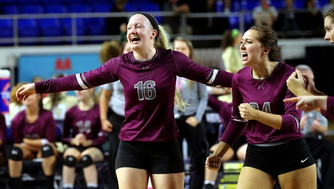 Eagleville's Kristin Barnes (16) and Hannah Cron (24) celebrate a point in the losers bracket game of the TSSAA Class A state volleyball tournament against Summertown, on Thursday, Oct. 22, 2015, at MTSU.