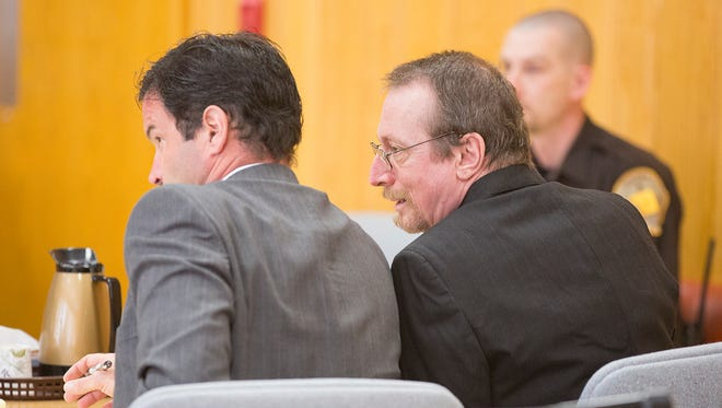 Joseph Reinwand, 56, right, talks to his defense attorney, Jeffrey Jazgar, in Portage County Circuit Court in Stevens Point, Monday, Feb. 22, 2016. He is accused of shooting and killing his wife, Pamela, 19, at their home in Plover on May 13, 1984.