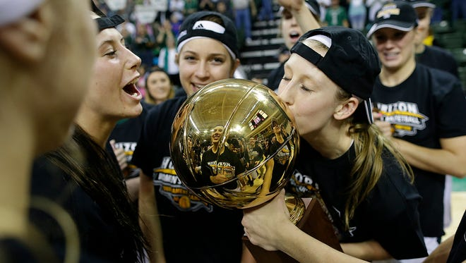 UW-Green Bay's Allie LeClaire kisses the trophy after the Phoenix defeated UW-Milwaukee in the Horizon League championship game at the Kress Events Center in Green Bay.