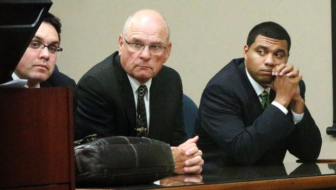 Devon Huerta-Person, right, listens with defense attorneys Dolph Quijano Jr., center, and Omar Carmona as Judge Patrick Garcia speaks to the jury after declaring a mistrial Friday evening in 384th District Court.