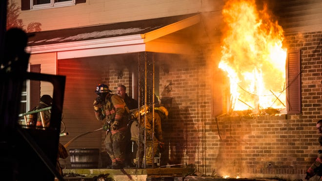 Emergency crews battle a fire that started in a first-floor apartment bedroom on Mill Street in Annville Township on Saturday, March 11, 2017. Arson was the cause of the fire, according to police.