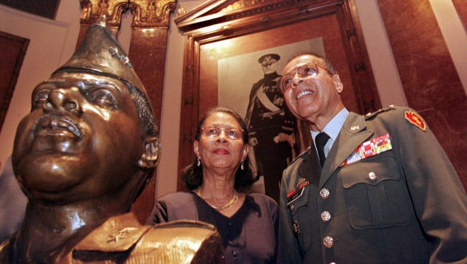 June Brooks and her husband Major General Harry Brooks Jr. stand proudly behind the bust of the retired general that was unveiled today at the Indiana World War Memorial's Pershing Auditorium Thursday June 10 1999.