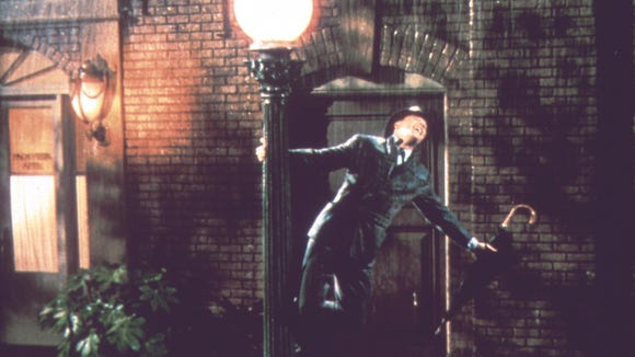 Gene Kelly performs his classic, soggy scene to the