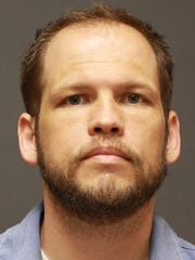 Adam Lee, a former part-time track coach at Apollo High School, is serving a prison sentence in Lino Lakes.