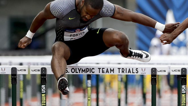 Jeff Porter wins his heat during the semifinals of the men's 110-meter hurdles at the U.S. track and field Olympic trials.