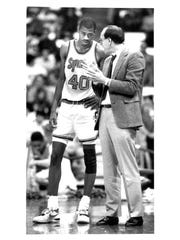 Tony Scott, left, talks with Syracuse coach Jim Boeheim during a game in December of 1988.