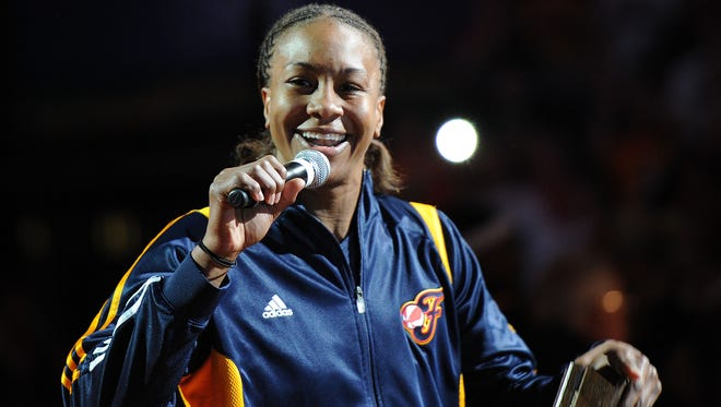 Tamika Catchings talks to the crowd after receiving her ring. Championship rings were presented to the 2012 WNBA champion Fever team before the game.