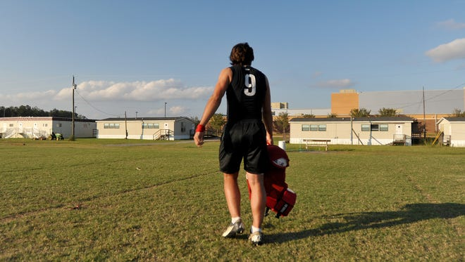 Brandon High School quarterback Gardner Minshew is the last player to leave the field after practice at the school.