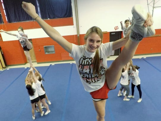 Victoria Caldiero, front, during a North Rockland cheerleader