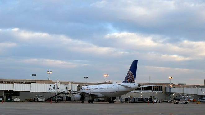 A commercial airline parks at a terminal at the Des Moines International Airport.