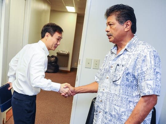 Ho Eun, left, Core Tech International Corporation owner, shakes hands with Yigo Mayor Rudy Matanane after a status hearing at the Office of Public Accountability in Hagåtña on Thursday, Aug. 11. The hearing was held in regards to an appeal filed by Core Tech against the Department of Public Works for the lease financing for the design, renovation, rehabilitation, construction, and maintenance of public schools.