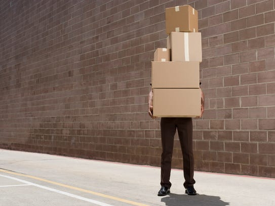person carrying boxes
