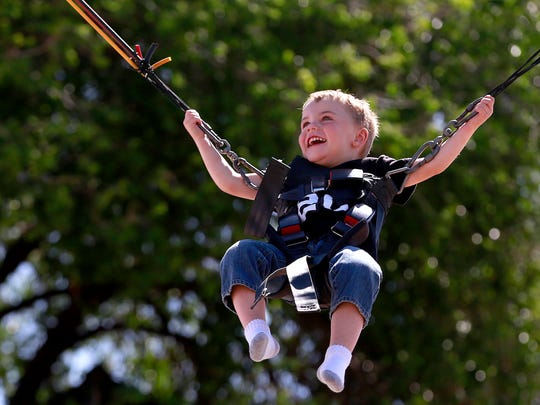 James Scoggins, 3, of Farmington goes for a ride on
