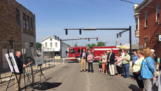 Jim Kennedy, president and CEO of Ohio Mutual Insurance Group, announces a donation of $50,000 Friday to help the city make up a funding shortfall for demolition of the old Bucyrus Theater, beside the building on East Warren Street.
