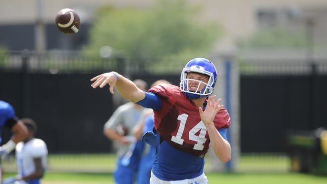 Junior QB Patrick Towles throws a pass during a University of Kentucky Football practice at the Tim Couch Practice Fields in Lexington, Ky., on Wednesday, August 18, 2015. Photo by Mike Weaver