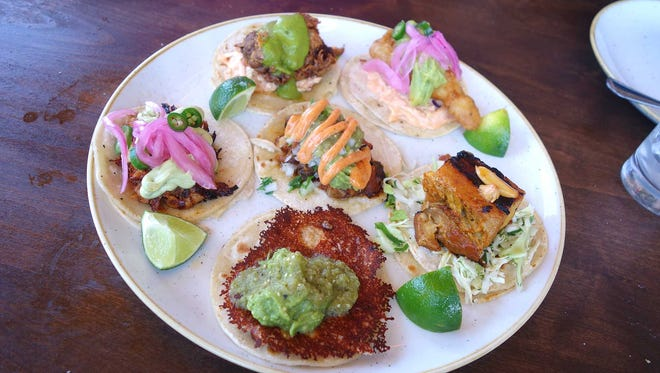 An assortment of tacos at Tacos Tequila Whiskey