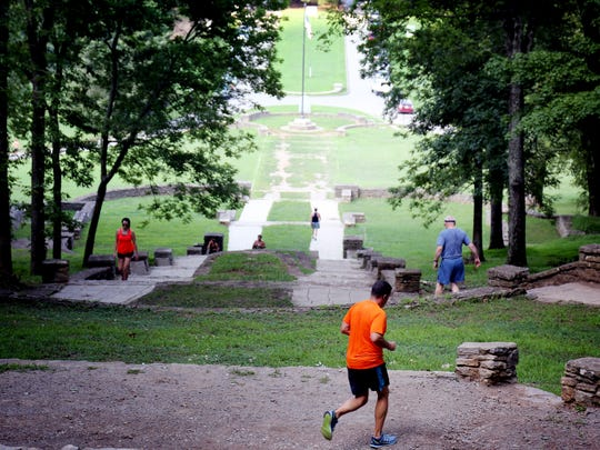 People get a workout climbing up and down the stone steps that lead to the trails within Percy Warner Park in Belle Meade on Aug. 8, 2016.